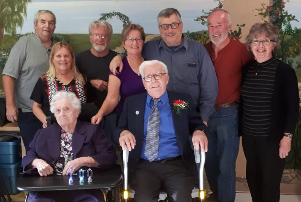 Mervyn and Emily with their children on October 23, 2018, Mervyn's 100th birthday. Emily and Mervyn in front, and Left to Right, Bob, Marilyn (Bill's wife), Bill, Janice, Art (Janice's husband), Dave, Joan (Dave's wife)